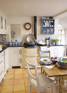 oh my, the perfect kitchen, blue, white, an AGA and a Le Creuset pot