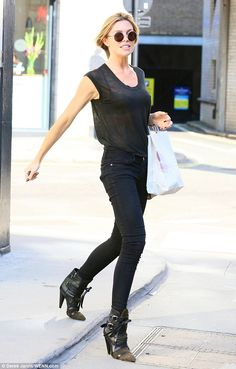 Abbey Clancy.. all-black.. sheer tee, lace bra, denim skinnies, and Isabel Marant Royston boots - fabulous!