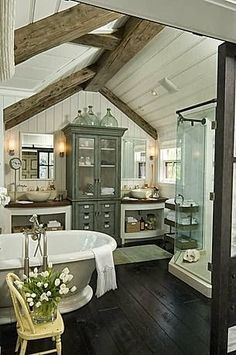 Love the apothecary cabinet between vanities, the beams, and the paneled ceiling