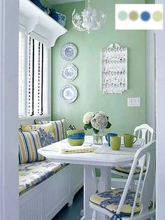 The window seat is used here to add further seating for guest in this apartment dining room. Decorated in shabby chic blending Light Room Colors green and blue . - Love the color palette. Banquette Design, Kitchen Banquette, Dining Nook, Kitchen Nook, Eat In Kitchen, Kitchen Decor, Banquette Bench, Kitchen Chairs, Nook Table