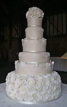 Wedding Cake Gallery flowers on the bottom more like a wedding cake