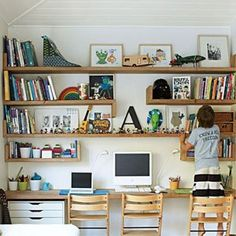 Love the idea of a wall o' shelves, and using a shelf for the desk.