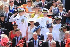 Salute: A group of US naval officers salute as the Queen is driven by en route to the Royal Enclosure