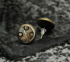 """""""BBC Doctor Who bronze tone earrings  Time Lord by TheSqueakyGeek, £7.99"""" So pretty and understated for most anyone- incognito geekiness!"""