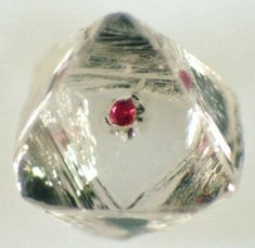 Garnet Inclusion in Diamond - can't imagine the price tag - ooo so beautiful #pixiecrystals
