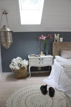 Gray, white, wood headboard, hardwood floors. Silver lantern. Great bedroom!