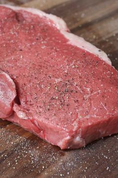 Closeup of a raw top sirloin steak seasoned with salt and pepper and rubbed with oil in preparation for pan frying Sirloin Steak Recipes Oven, Seared Steak Recipe, Pan Seared Steak, Sirloin Steaks, Steak Marinades, Stove Top Recipes, Mug Recipes, Beef Recipes