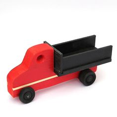 Wooden toy truck, delivered in parts for assembly