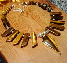 New in our shop! Gorgeous pure raw tiger's eye and crystal bohemian statement necklace, bohemian necklace, statement necklace, boho necklace, silver, gold https://www.etsy.com/listing/568088259/gorgeous-pure-raw-tigers-eye-and-crystal?utm_campaign=crowdfire&utm_content=crowdfire&utm_medium=social&utm_source=pinterest