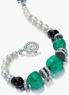 CARTIER - AN ART DECO EMERALD, DIAMOND AND NATURAL PEARL BRACELET, CIRCA 1925. With French assay marks and maker's mark, Signed Cartier, Paris, numbered. #Cartier #ArtDeco