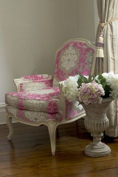 Cream painted armchair with lush thick fuchsia and cream fabric.