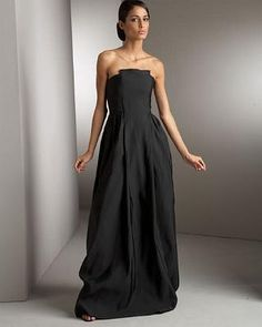 http://dressesmania.com/slides/Elegant%20design%20of%20strapless%20black%20evening%20dress%20gown.html