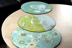 DIY Cupcake Stand -- made out of cardboard cake circles, scrapbook paper and plastic cups! Great for disposable needs.