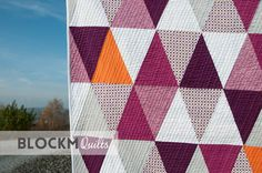 Beautiful quilt finish by Daniela O'Connell of #BlockMQuilts! The fabrics she used are Robert Kaufman Fabrics Kona white, berry and cerise, Carolyn Friedlander's cross hatch in grey and plum, and micro mod/ vertigo by Cloud9 Fabrics. The pop of orange is from Oakshott Fabrics. Daniela did her quilting with her favorite Aurifil 40wt thread!  To see more, please visit: http://www.blockmquilts.com/2016/11/porcupine-playground-triangle-quilt.html