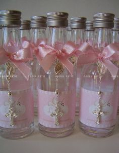 Baptism ~ Joint Boy/Girl ~ Favors ~ Bottles filled with Holy Water and attached with a small finger rosary.  |  Brown labels with white wording. Brown Ribbon for bow and a slip of pink and a slip of blue to attach behind the bow. Attach a white rosary and the Liston.
