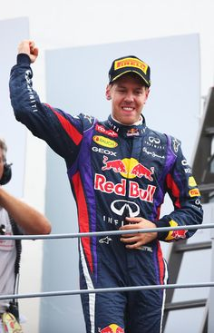 Sebastian Vettel Sebastian Vettel of Germany and Infiniti Red Bull Racing celebrates on the podium after winning the Italian Formula One Grand Prix at Autodromo di Monza on September 8, 2013 in Monza, Italy.