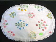 Pinned by Tam by www.babybites.co.nz Springtime Floral Placemats, Never Used, Eyelet trim. $6.00, via Etsy.