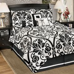 Beauville - Ebony 7-Piece Bedding Set Q10000-set by Ashley Furniture. $189.25. Aesthetically appealing, this bedding set exemplify boldness, elegance, vivaciousness, simplicity and adaptability. This set is a great addition to any type of home. Accentuate your bedroom decor with this 7-piece comforter set. This set includes an oversized comforter, two shams, a bed skirt, and 3 decorative accent pillows.