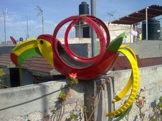recycle old tires making garden colourful parrot tire planter of used rubber tires fence backyard