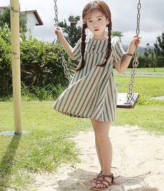 Today's Hot Pick :Stripe Smock Mini Dress http://fashionstylep.com/SFSELFAA0009261/thejany4/out This season would be more fun if your child is feeling fashionably chic with the dress that she is wearing. The mini dress features round neckline, short sleeves, stripe print and mid thigh hemline. The ensemble will look best if worn with thong sandals and braided hair.
