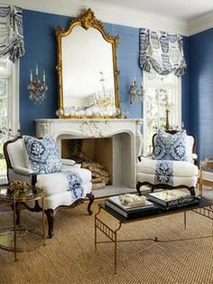 LIVING ROOM & FAMILY ROOM – We love the navy blue grasscloth wallcovering in this living room - Traditional Home / Photo: Werner Straube / Design: Megan Winters