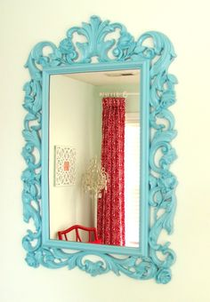Ornate turquoise mirror...would look pretty on your gray walls. You could find a cute one at a yard sale, antique or thrift store and paint.