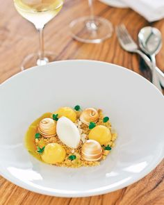 Colagreco's tart made with Menton's famed lemons: fresh and dry meringues, meringue ice cream, Brittany biscuit, and yuzu sauce. Mauro Colagreco - Mirazur - Menton