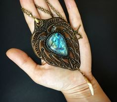 Fantasy pendant with amazing blue labradorite by Gemsplusleather - 49.94$  #labradorite #LARP #Western #fantasy #wild #tribal #cabochon #fang #tooth #wolf #jewelry #jewellery #pendant #stylish #womensfashion #gem #Gemsforall #gemstone #Gemsplusleather #tooledleather #leather #carvedleather #handcarved #handmade #handmadejewelry #handmadewithlove