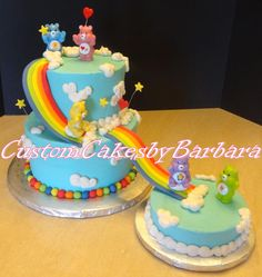 Carebear themed cake.  Rainbow is made out of gumpaste.