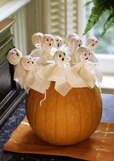 One of the easiest and most effective child-friendly pumpkins we've come across. Little lollipop ghosts can be wrapped and decorated by your children and then stuck into pre-skewered holes in the pumpkin.