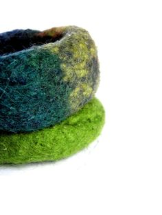 Two crocheted and felted wool bangles green petrol  di Leccio51, €18,00