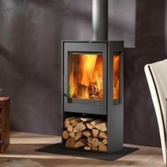 The Dik Geurts Kalle is a three sided glass wood burning stove allowing for views of the flames from around your living space. Small Wood Burning Stove, Outdoor Wood Burning Fireplace, Fireplace Logs, Fireplaces, Outdoor Wood Burner, Contemporary Wood Burning Stoves, Wood Paneling Makeover, Stove Installation, Freestanding Fireplace