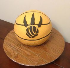 Toronto Raptors Basketball Cake. White cake with vanilla buttercream, and fondant accents. #basketball #cake #raptors #torontoraptors