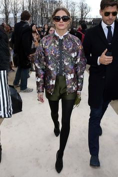 Celebrity Street Style: The 10 Most Stylish Stars - Olivia Palermo wearing Valentino | graphic print bomber worn with olive green short + black tights and pointy black heels: