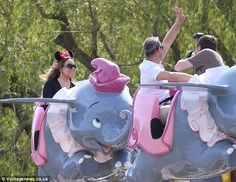 Family fun: Mariah appeared to be loving the theme park just as much as her daughter did