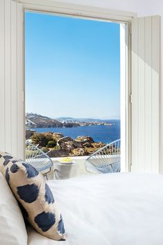 Smart, stylish and supremely dreamy - these are the hottest places to stay on Greece's party island this summer