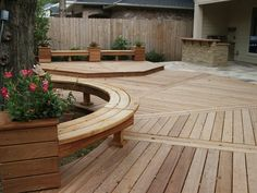 Angelim deck with radius benches, planters, flagstone patio, and outdoor kitchen in the Kingwood, Texas area.