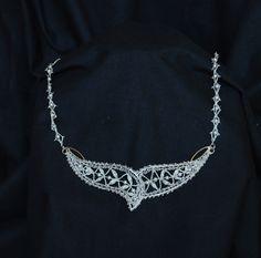 Bobbin lace necklace. Interior made of bobbin lace with silver thread Aquila 925. Christina Bravi