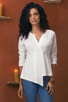 Hayden Top Simple, architectural surplice style flows from the empire waist to an asymmetrical point hem on this long-sleeve to. Exceedingly flattering and easy to style in l Kurta Designs Women, Blouse Designs, Empire Waist Tops, Western Tops, Asymmetrical Tops, Casual Tops, Designer Dresses, Tunic Tops, Couture