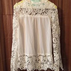 Cute white blouse Beautiful white blouse bought off website China sizing way too small. It was suppose to be an XL it's a small. Never worn NWOT Tops Blouses