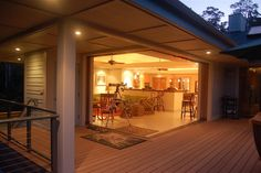 Island, Glass Door & Canopy Placement and Deck Color Theme -  Covered Patio,  Steel Cable Railing,  Wood Flooring,  Outdoor Lighting & Ceiling Lighting