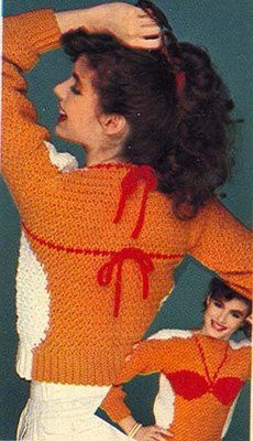 She sure is happy for someone wearing the worst sweater ever.