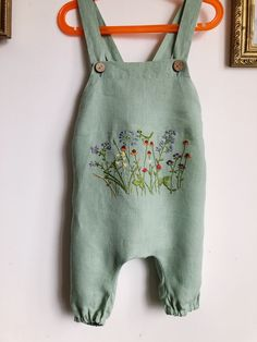 Botanical hand embroidery for customer provided clothes