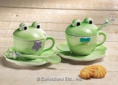 "Start your morning with these characters and it's bound to be a good day. His 'n hers frog mugs come with lily pad saucers, lily-handle spoons, and best of all, lids to keep your coffee (or tea) nice and hot. The kids will love drinking hot chocolate out of them too. Each holds 7 oz. Ceramic. Hand wash. Cups: 4 3/4""L x 4""W; saucer: 61/2"" Diameter."