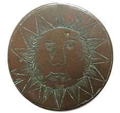 This early love token features a sun engraved with scrimshaw technique on an English half penny. (Courtesy of the Love Token Society)