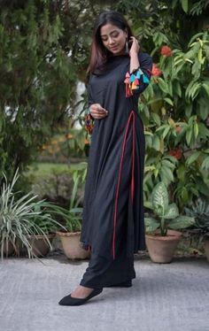 92d0374f0 The elegance of black palazzo suits, portrayed by its steal #black color  with #