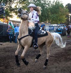 A cowgirl and her Palomino at the Canby Rodeo during the 2012 Clackamas County Fair./Christopher Communications