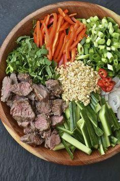 Thai Beef Salad. ginger. garlic. lemon grass paste. honey. lime. shallots. fish sauce. sirloin steak. romaine lettuce. spring onion. mint. bell pepper. cucumber. peanuts. jalapeño.