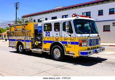 A yellow and blue fire truck of the Santa Paula Fire Department in California - Stock Image