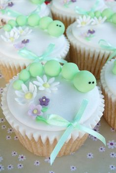 Caterpillar Cupcakes - These are too cute. I would do them in bright colors and not so girly.
